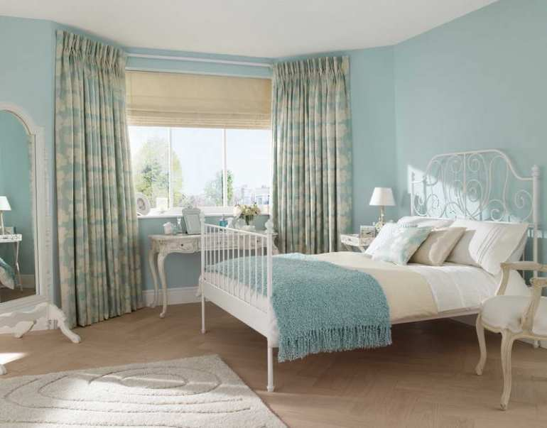 Types-of-Noise-Reducing-Curtains-With-Light-Blue-Wall